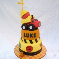 Tonka Themed Dump Truck Cake A Tonka themed dump truck cake made to match the invitations and decorations for my son's 4th Birthday.