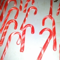 Candy Canes! My first year making candy canes! Gotta admit I used cinnamon flavor instead of the traditional peppermint and I love it.