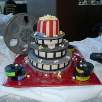 Movie Reel Cake One of my best friend's got married this weekend, and I did the groom's cake as a gift. He used to work at the local theater as a...