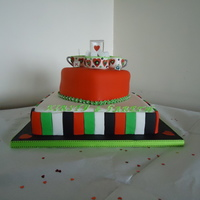 "Tea For 2 Engagement Cake 12"" square carrott cake covered in fondant, red velvet heart on top, covered in fondant with gumpaste ascents, cups, sugarbowl, ring..."