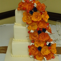 """orange Rose Summer Wedding Cake' This is a 3 tier cake wedding cake featuring hand-sculpted gumpaste roses and buds. Every large rose was petal dusted with 4 different..."