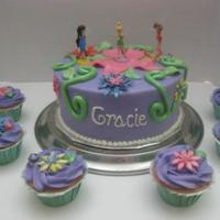 Tinkerbell Cake And Cupcakes Buttercream base with fondant decorations. Tink and other fairies are toys. Not even going to try it! First time not using all edible...