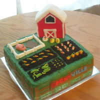 Farmville Buttercream icing with fondant animals. Barn is RKT covered in fondant.