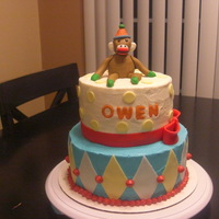 Sock Monkey Cake white chocolate buttercream icing on fudgey chocolate 8' and 6' cakes. fondant accents with fondant monkey. made to match the...