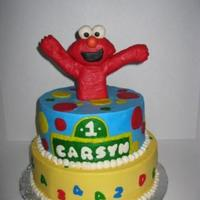 Elmo 1St Birthday All buttercream covered cake with Fondant covered rice crispy treat Elmo.
