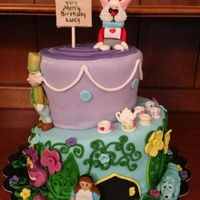 Alice In Wonderland All characters are made of fondant. I made Alice with brown hair to look like the special little girl who got this cake.