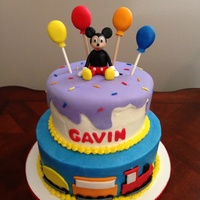 Mickey Mouse Train Cake This is an Icing Smiles cake made for a little cutie who loves Mickey and trains. Mickey is made of fondant.