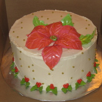 Friends Family Party Cake poinsettia cake with gold accents, buttercream with chocolate cake