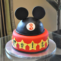 "Mickey Mouse Cake Thanks to ""loveandsugar"" for her wonderful inspiration for this cake. Cake is a chocolate mousse cake covered in mmf with gum..."