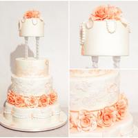 "Peaches & Cream 6"", 8"", 10"" cakes, 9"" separator, 15"" petal shaped cake as the bottom tier."