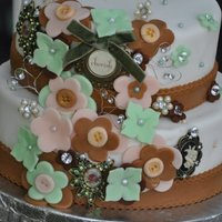 My First Wedding Cake The Bride had made felt flowers for all the arrangements with antique jewelry for accents. I used her flowers to make her a cake in the...
