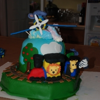 Train, Planes And Animals Cake This cake was for my son's 2nd birthday. When I asked, he wanted trains, planes and animals. This is what I came up with. It is an...