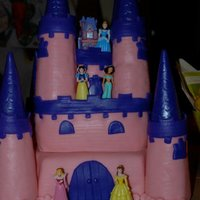 Princess Castle Cake This is a princess castle cake that I made for my daughter and her friend's 4th birthday. It is a 3 layer cake, with MMF. The turrets...
