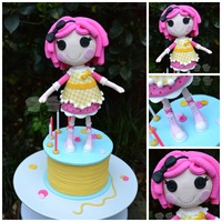 Lalaloopsy Crumbs Sugar Cookie  My daughter's 5th birthday cake. Crumbs Sugar Cookie LaLaLoopsy doll standing on a spool of thread. She is made from fondant and gum...