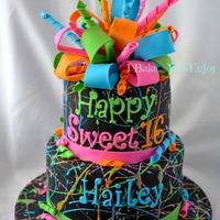 "Splatter Paint Cake I Loved Splattering The Paint Royal Icing Onto The Black Canvas Topped With A Colorful Poofy Bow Made Of Gum Pa  Splatter Paint Cake * I loved splattering the ""paint"" (royal icing) onto the black canvas! Topped with a colorful poofy bow made..."