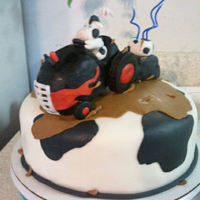 Moo Cow Cake This was for a little one turning 3!! He loves tractors, mud/mudding trains and cows.. I got most of them on the cake ~:) The tractor is...