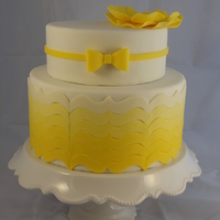 Yellow Ombre Bracket Cake I made this cake with spring in mind, hence the sunny yellow color. It was just for fun. The decorations are all modeling chocolate. The...