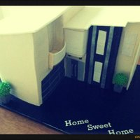 "3D Townhouse Cake! This cake was made to imitate the clients house! The cake sat at 11"" tall!Perfect for a house warming party :)"
