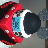 50Th Mickey Mouse Cake This cake was made for a lady who is a Mickey Mouse fanatic!!!! All tiers were choc mud cake with choc ganache layers :) Ears were made...