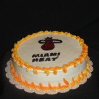 Miami Heat Cake   10in round vanilla cake with guava filling covered in buttercream. Logo is fondant.