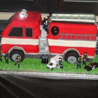 3D Fire Truck With Working Lights  Birthday cake for a special 5 year old boy. The party was held at a Fire station museum. Vanilla cake with vanilla buttercream filling and...