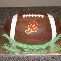 Redskins Football Cake is covered w/buttercream frosting with fondant decorations.