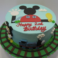 "Mickey And Thomas 8"" round yellow cake with vanilla BC filling. Covered in BC w/fondant accents. TFL"