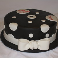 Dots Chocolate cake filled with Chocolate ganache and covered in fondant.