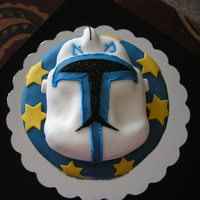 Star Wars Trooper Dark chocolate cake, fondant and icing. Helmet 3D also in dark chocolate cake. A special treat for my 7 year old nephew for his birthday.