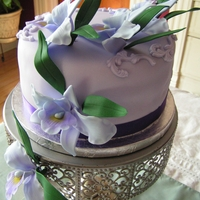 Lilac Cattleya Orchids Orchids were made of fondant. The cake is polenta-almond with mixed berries mousse filling
