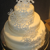 New Year's Eve Wedding Red Velvet cake with Cream Cheese Icing, covered in ivory fondant . Snowflakes are gumpaste.`