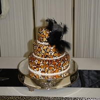 Leopard Print Wedding Cake Hand-painted leopard print complete with a feather fascinator:)