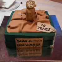 "Company 20Th Anniversary Cake Iconic Gold Watch Made To Look Like Rolex Box Covered In Fondant With Fondant Details Company 20th Anniversary cake Iconic ""Gold Watch"" made to look like rolex box Covered in fondant with fondant details."