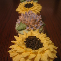 "Flower Cupcakes My first attempt at some ""fancy"" cupcakes. I did sunflowers and hydrangeas. This was also my first attempt at playing with the..."