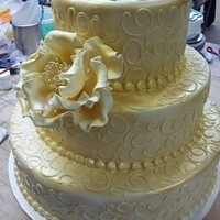Gold Wedding Cake Tiered Cake with scrolls airbrushed gold. Gold peony. Sorry for the messy background :-/