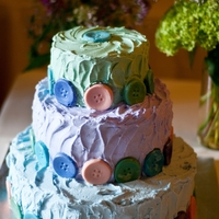 Button Wedding Cake   This cake was a buttercream cake with colored white chocolate buttons.