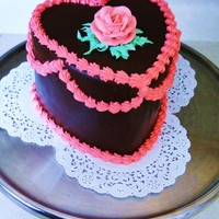Valentine's Day Heart This cake was a devil's food cake covered in dark chocolate ganache and buttercream decorations.