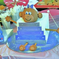 Baby Monkey Playing The Xylophone This cake was a carrot cake with cream cheese frosting. The decorations are all fondant, with silver dragees as the screws for the...