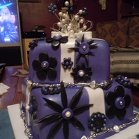 Lauri's Birthday Cake Made from scratch Italian Cream Cake, 6 in, sq. and 8 in. sq. covered in purple MMF. Decorations made with black MMF and beads. I bought...