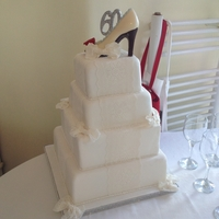 60Th Birthday White Cake Complete with with lace sides, bows and a chocolate shoe