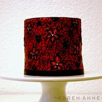 Black Lace (Wedding) Cake This cake was painted red metallic, with royal icing lace flowers and hand painted black lace.