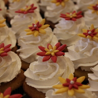 Red And Yellow Wedding Cupcakes Red and yellow fondant daisy cupcakes for a wedding