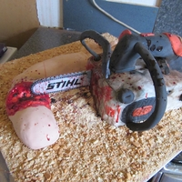 Friday The 13Th - Chain Saw Cake My first motorised cake, the chain went round as well as the engine noise and chain noise, everything was either cake or moulded from...
