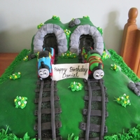 Thomas And Percy Wish Daniel Happy Birthday The hills and land are all cake and Thomas and Percy are all hand moulded out of fondant and sugar paste. Everything is edible.