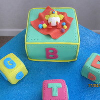 Baby Shower, Duck Theme My friend wanted a duck in a nappy incorporated in the cake, this is what I came up with...... the big block has 'B' for baby,...