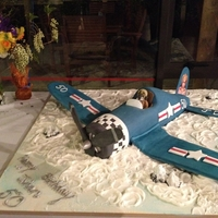 F4U Corsair 50Th Birthday A replica of the birthday boys favourite plane with a figurine of him flying it hand made out of fondant.