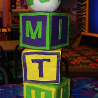 Alphabet Blocks Cake It was supposed to be a pile of blocks with football revolving on top. Its not as good looking as I wanted to make it. My 5 month old first...