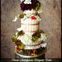 Country Diva Wedding Cake   Rustic style wedding cake.Got inspired by the barrels used to crush grapes and make wine. Thank you for looking.
