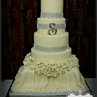 Ultimate Fantasy Ivory fondant cake with lots of bling and white and cream flowers.