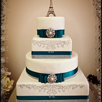 Paris Romance Fondant covered cake with hand painted accents. Satin ribbon/bow and glitz broach.